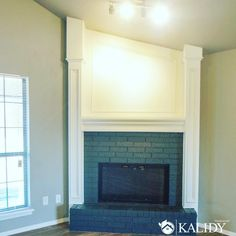 Nothing makes more of a statement in a living room than a luxury fireplace! How regal does this one look?   We love how it accentuates the sloped ceiling! The white mantle pops against the grey brick and beige walls. There is so much to love about this design! What is your favorite part?