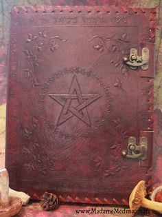 Large Brown Leather Book of Shadows with Embossed Pentacle/Pentagram   A very grand book of shadows/spell book at a whopping 35cm tall   Beautifully crafted in dark brown leather and embossed front and back with stunning pentacle design – inside is unlined hand-made paper. If you want an old-style authentic book of shadows, look no further!  Preserve your most precious spells and rituals for future generations - a true family heirloom  www.MadameMedusa.co.uk