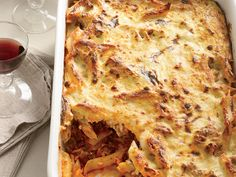 Greek Baked Pasta | The moist and fragrant casserole pastitsio combines béchamel (a sauce of butter, flour and milk), pasta, ground lamb, tomato sauce, cheese, cinnamon ...