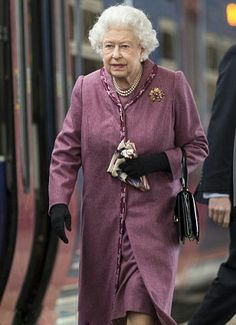 Queen Elizabeth wore a pair of plain black gloves and appeared to be carrying one of her trademark headscarves.  As she returns from seven-week festive Sandringham break looking very refreshed on 10 Feb 2014
