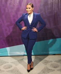 Adrienne Bailon strutting her stuff in a BCBG jacket and pants, Kooples LA top, Saint Vintage accessories, and sponsored Jinny Kim shoes.