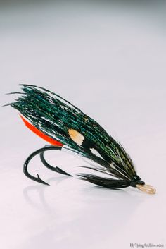 AlexandraSimple pattern that's better known as a trout fly and was quite controversial fly early on in the trout streams of England. This version however is aimed more for salmon and I tied it on an antique double hook to give it even more bulk.The dressing is nice and simple but there are couple things to note on the wings. Make sure that you get feathers from both right and left side when buying Peacock sword feathers. It's important to have equal amount of fibers from both sid...