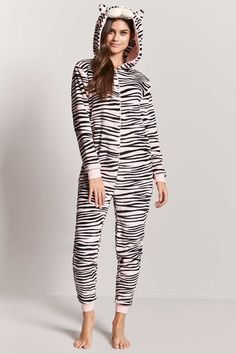 FOREVER 21 Plush Tiger Onesie A plush knit pajama onesie featuring a zip-front, a hood with a tiger face graphic and protruding ears, long sleeves, contrast trim, and an allover tiger print. #affiliate