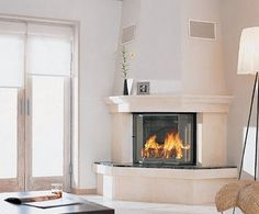 White living room village corner fireplace