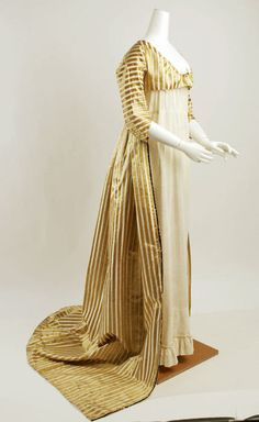 A 1797 gold striped overdress over a typical white regency dress shows the last remnants of the robe and petticoat mode of fashion that dominated the 18th century.