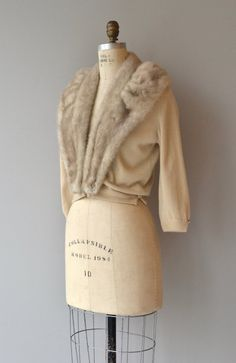 Vintage 1950s cream lambswool cardigan with huge large blonde mink collar, 3/4 sleeves three clasp closures at the waist and sheer lining. Fur snaps