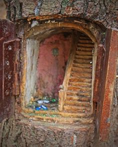 "Fairy Door carved staircase into tree! Pinner says ""My Mom had a fairy garden every spring, each time it would rain the faireis would leave something new in the garden! The girls could not wait to see what treasure was left behind."" What a magical idea! Fairy Village, Fairy Tree, Fairy Garden Houses, Gnome Garden, Fairy Gardens, Fairies Garden, Miniature Gardens, Fairy Dust, Fairy Land"