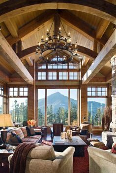 What a grand living room space in a beautiful log cabin - love the openness!