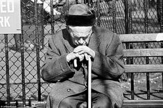 Leland Bobbé - In the Lower East Side, an old Jewish man leans on his cane at a park bench