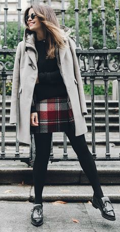 Sara Escudero + pair of shiny patent loafers + tartan mini skirt + cute cropped sweater + gorgeous cream duffel coat + suitable for any season + adapted to any weather!  Coat/Skirt: Fay, Jersey: Asos, Loafers: Zara.