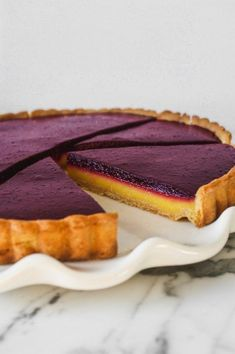 A naturally sweetened lemon and blueberry tart from the new Naturally Sweet cookbook from Americas Test Kitchen. Perfectly sweetened this tart is a gem. The post Stunning Blueberry Lemon Curd Tart appeared first on Win Dessert. Just Desserts, Delicious Desserts, Dessert Recipes, Yummy Food, Baking Recipes, Dinner Recipes, Dessert Tarts, Fruit Tart Recipes, Easy Dinner Party Desserts