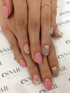 Neutral & pink nail art with sparkles gold & rhinestones