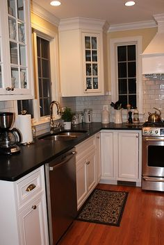 example of what I don't like.  hmmm...I had thought black countertops with white subway tile, but don't like it here.