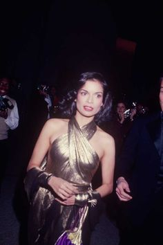 ELLE loves... Bianca Jagger's disco style in this gold halter-neck dress. Click through for more celebrity style inspiration.