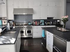White Kitchen Cabinets With Gray Granite Countertops kitchen of the day: a luxury white kitchen with a beautiful range