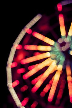 I Absolutely LOVE Ferris Wheels,I can set and watch them for hours,especially at night..when they shine so bright! :)