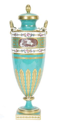 A Minton vase and cover, circa 1870 Of tall upright form with double garland and ribbon tied handles, on a short stem and square base, the bright turquoise-green ground reserving small vignettes depicting classical scenes flanked by narrow bands of flowers, the lower band gilded with a band of stiff leaves,