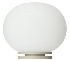 Flos Glo-Ball Mini Table Lamp White by Jasper Morrison. A small, unobtrusive desk lamp in the style of Jasper Morrison's Glo-Ball light. Made from white, hand blown Murano glass, the Mini Glo-Ball has a natural diffusion that provides a soft, warm white light, perfect for working or reading by. Click here to download the full technical specification [pdf] Notes : Lighting Buying Guide Dimensions : Overall: H9 x Dia. 11cm Bulb: Requires 1 x G9 HSGS Halogen bulb 20W Max