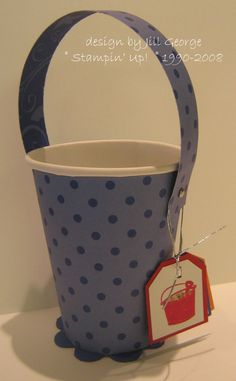 Embellish a paper cup to use for party favors.  Cute!