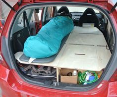 Ultimate Road Trip Car Conversion (Honda Fit) When my wife and I found out that we had two months to take the cross-country road trip of our dreams, I immediately knew that I was going to transfor… Auto Camping, Minivan Camping, Walmart Camping, Truck Camping, Tent Camping, Camping Gear, Camping Hacks, Camping In The Rain, Motorcycle Camping