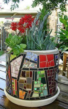 Image result for mosaic flowers in vase on table in front of window