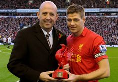 Stevie award for 600 LFC games - Liverpool FC. Receiving from Gary McAllister, an LFC legend in his own right Liverpool Fc Website, Steven Gerrard, Liverpool Football Club, Sports Activities, Competition, Champion, Statue, Bird