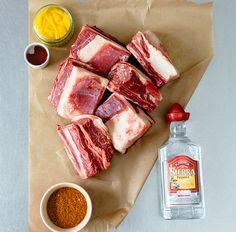 beef-ribs on the MiniMax Big Green Egg Ingredients 1 tbsp sea salt 1 tsp cayenne pepper 1 tsp onion granules 1 tsp garlic granules 1 tsp smoked paprika 1 tbsp ground cumin 1 tbsp chilli powder 8 beef short ribs American yellow mustard Barbecue sauce Chives and chillies to garnish