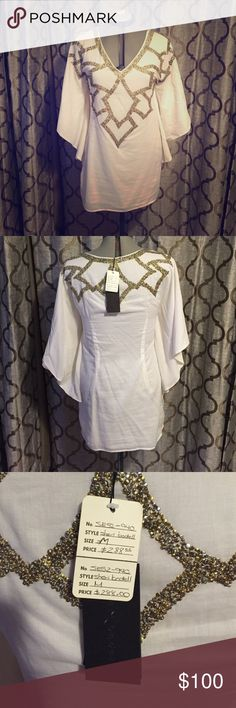 Gorgeous Sheri Bodell Tunic Dress NWT This is a beautiful cream tunic dress with extravagant beading. Absolutely gorgeous! Sheri bodell Dresses Mini