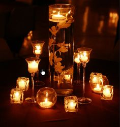 Centerpieces- Glue fake orchids to rock, drop in vase, fill with water top with floating candles and add fish
