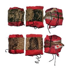 Fabric bundles made with 'shoe print' screen printed fabrics and twine.