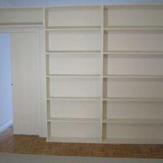 free-standing bookcase divider with hide away pocket door - Yelp