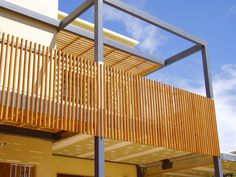 And you could also have a vertically slatted balustrade. This one looks great with the contrasting grey posts. A pergola like this might be the way to achieve more structural integrity and you could use it to attach a shade sail in the summer. Timber Handrail, Outdoor Handrail, Patio Railing, Timber Battens, Balcony Railing Design, Wood Railing, Deck Balustrade Ideas, Balustrades, Railing Ideas
