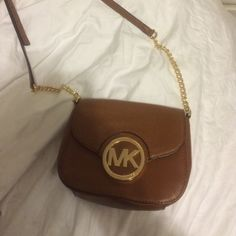 Michael Kors crossbody bag Never used, brand new cross body bag with gold chain and accents Michael Kors Bags Crossbody Bags