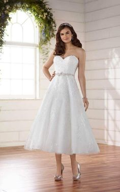 D2231 by Essense of Australia. For the bride wanting to go with a shorter style on her wedding day, this tea length wedding dress with subtle shimmer is the perfect option! With all-over beaded lace detailing, this Lace and Tulle over Regency Organza gown is complete with a Diamante-beaded belt – the perfect touch of glamour for this style.