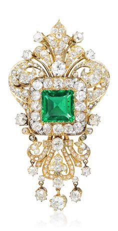 A magnificent Victorian 18k gold, emerald and diamond brooch, circa 1860. Featuring a modified square step-cut insignificantly oiled Colombian emerald, weighing approximately 4.88 carats, further decorated with high quality old mine-cut diamond sprays.