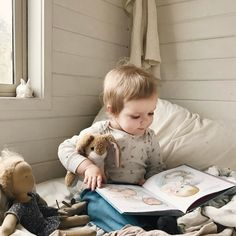 nurturing spaces can be intentional and quaint — a basket of favorite books & friends in a cozy spot.
