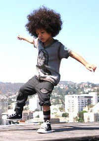 I hope my kid has a fro.. His father could never grow one :(