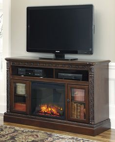 North Shore Large TV Stand with Fireplace by Ashley - Home Gallery Stores