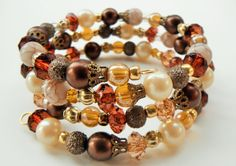 Beautiful vintage inspired wrap bracelet features a mix of vintage and repurposed beads in brown, faux pearl, amber and gold. Lovely for special occasions or everyday!