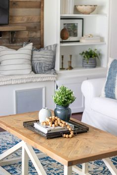 The Basics of Coffee Table Styling - Shades of Blue Interiors Small Coffee Table, Coffee Table Styling, Decorating Coffee Tables, Small Tables, Living Room Candles, Small Potted Plants, Square Tray, Blue Pottery, Wood Tray