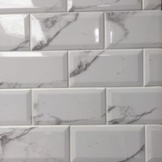 Metro Carrara White Bevelled Brick Tile Metro Carrara white tile is a bevel edge, brick gloss wall tile by Salcamar Vilar. A marble print in the style of carrara marble instead of a pure flat colour. White Brick Tiles, Grey Wall Tiles, Marble Wall, Brick Wall, Marble Print, Metro Tiles Bathroom, Kitchen Wall Tiles, Marble Bathrooms, Gold Bathroom