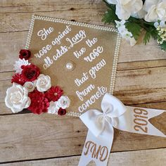 Red, gold and white graduation cap topper