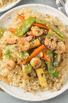Healthy Shrimp Stir Fry is an easy, quick meal done in under 20 minutes. Use rice or keep it paleo, whole30 and keto / low carb with cauliflower rice! A clean eating dinner everyone will love. The sauce is delicious and works well on noodles too! Healthy Gluten Free Recipes, Healthy Dinner Recipes, Whole30 Recipes, Healthy Dinners, Lunch Recipes, Yummy Recipes, Recipies, Healthy Meal Prep, Healthy Cooking