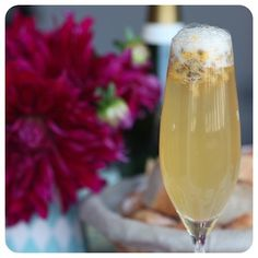 FIZZY PASSION.            6 dessert spoons ORANGE FLOWER WATER sweet PASSION FRUITS (or GRANADILLA)    1 bottle CHAMPAGNE or PROSECCO