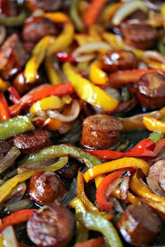 This sheet pan sausage and peppers recipe is simple to make yet full of flavour. It's perfect to eat on its own or pile it high on a hoagie bun. One pan, a few simple ingredients, and you have the perfect lunch or dinner recipe. Ketogenic Recipes, Keto Recipes, Cooking Recipes, Flour Recipes, Avocado Recipes, Yummy Recipes, Dessert Recipes, Sausage Peppers And Onions, Stuffed Peppers