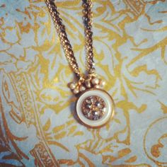 Vintage 1800's button pendant with mother of pearl brass button.
