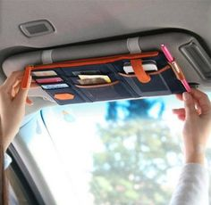 Car Sun Visor Storage Organizer - With Notepad and Pen Holder. Easy way to hold phone, licence and registration, parking receipts, etc. right where they are needed. Declutter your dashboard! http://bratsonboard.com/products/car-sun-visor-storage-organizer-with-notepad-and-pen-holder #CarOrganizer #CarStorage #Visor