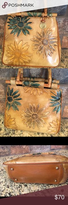 """Brahmin sunflower 🌻 embossed leather harbor bag Brahmin bag. Very cute embossed leather sunflowers 🌻. Excellent condition. Missing cross the body strap. Has bamboo handles. Measurements 10""""x9"""" and 4"""" strap drop. Brahmin Bags Satchels"""