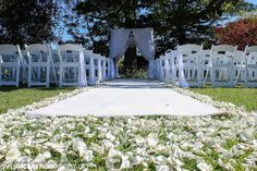 Romantic and classy white wedding ceremony aisle with carpet and petals - Josef Chromy Winery