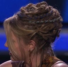 Bangs tucked back into hairstyle over some of her locks. I love the subtle tones of the hair wraps too!